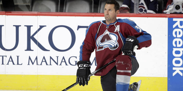 Colorado Avalanche's Francois Beauchemin kneeling before a game