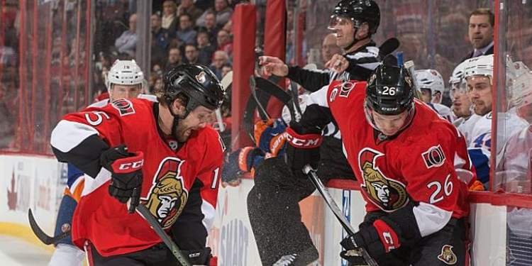 Zack Smith #15 and Matt Puempel #26 of the Ottawa Senators