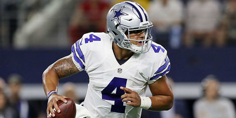 Cowboys player Dak Prescott in action