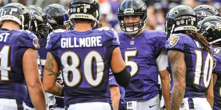 Baltimore Ravens players gathered around