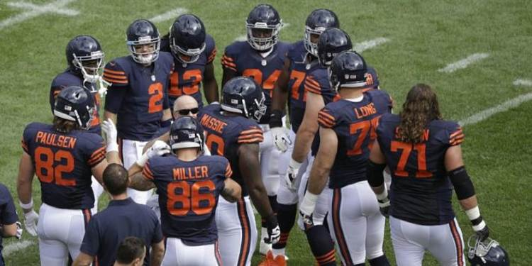 Chicago Bears players gathered around