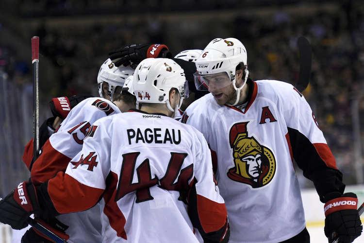 Ottawa Senators players on the ice rink