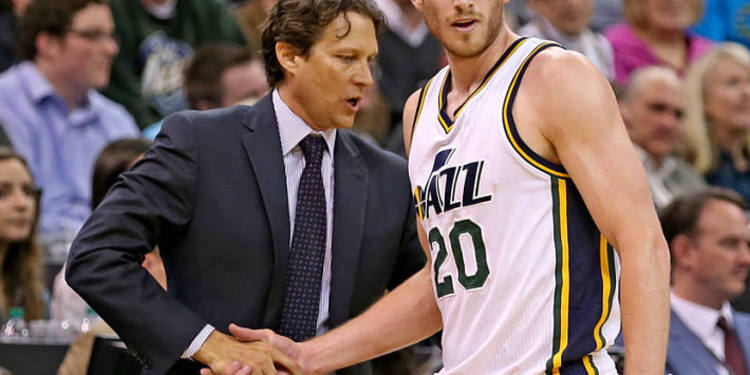 Utah Jazz head coach shaking hands with player