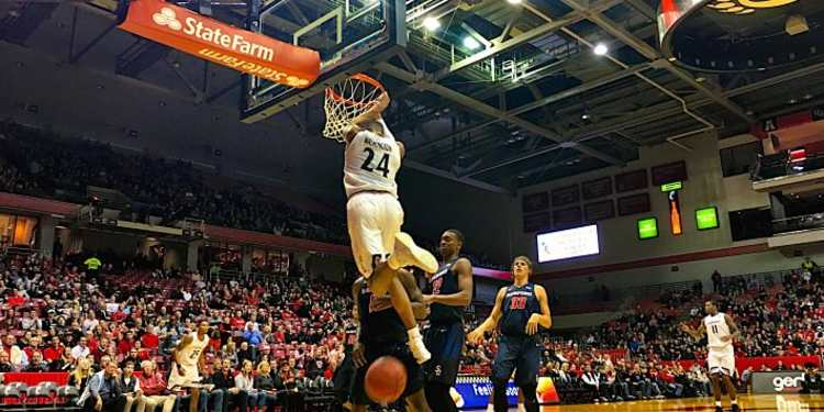 College Basketball Player Dunks