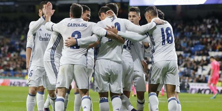 Real Madrid players celebrating after a goal