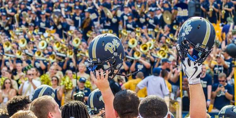 Pitt Panthers Holding Their Helmets high