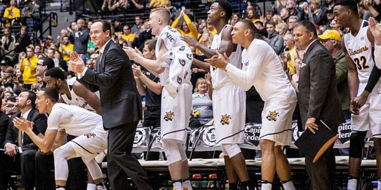 Wichita State Shockers players cheering for their teammates