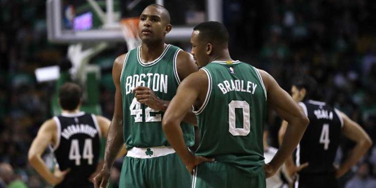 Boston Celtics players in court