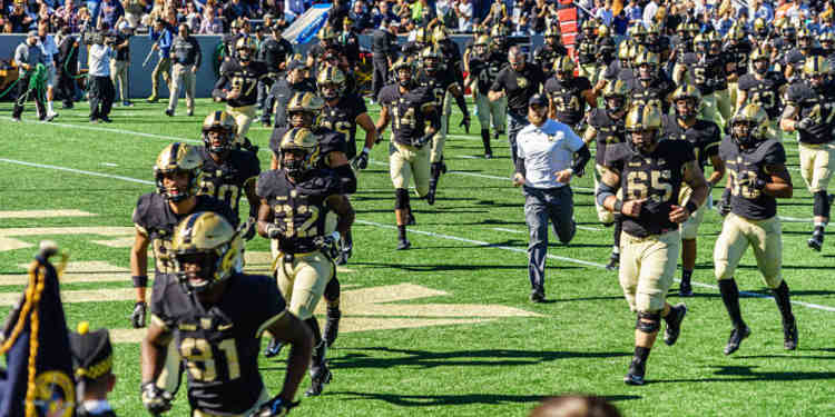 Army Black Knights players running into the field
