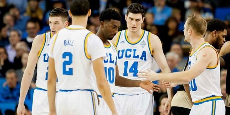 UCLA Bruins players gathered around