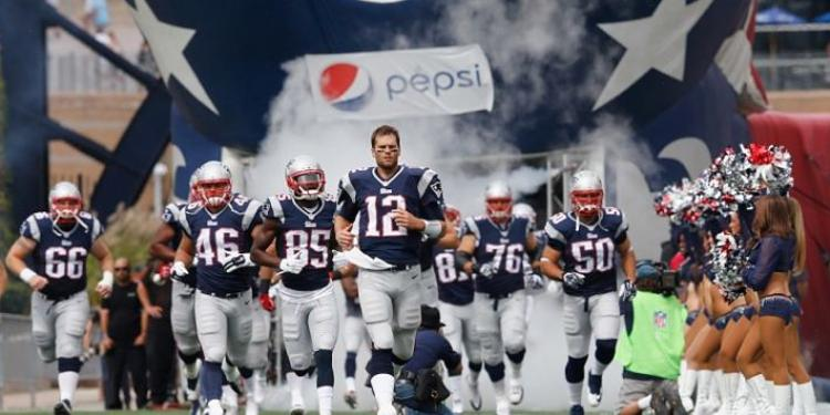 New England Patriots running into field