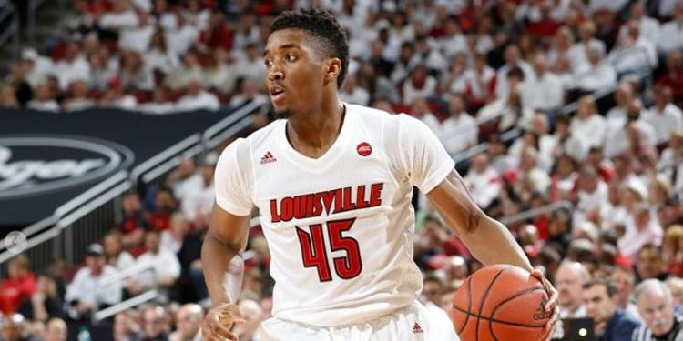 Louisville Cardinals player in action