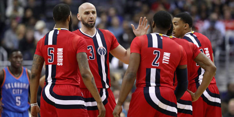 Washington Wizards  players gathered around