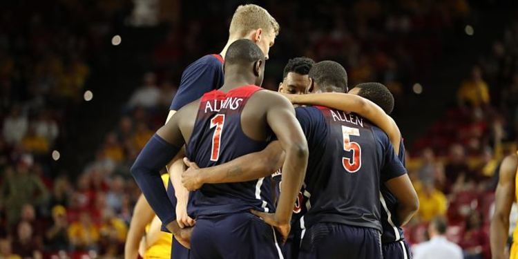 Arizona Wildcats players gathered around