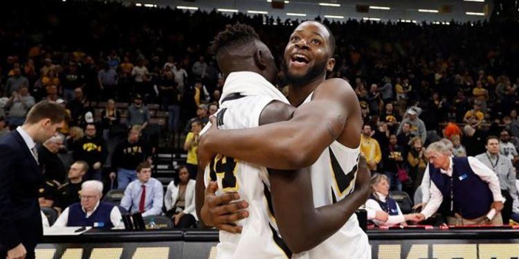 Iowa Hawkeyes players hugging