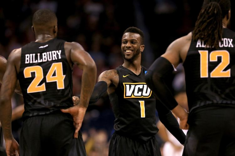 VCU Rams Players on Court wearing black team jersey