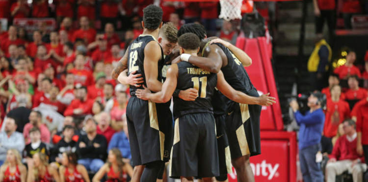 Purdue Boilermakers  players gathered around