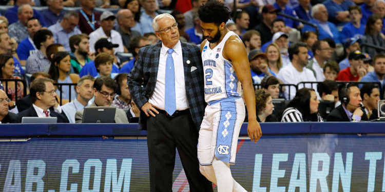 North Carolina Tar Heels player with coach