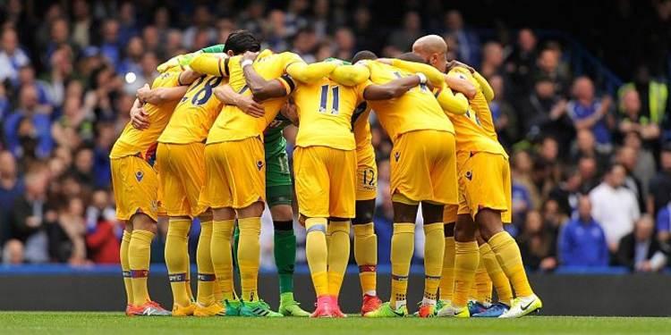 Crystal Palace team gathered around
