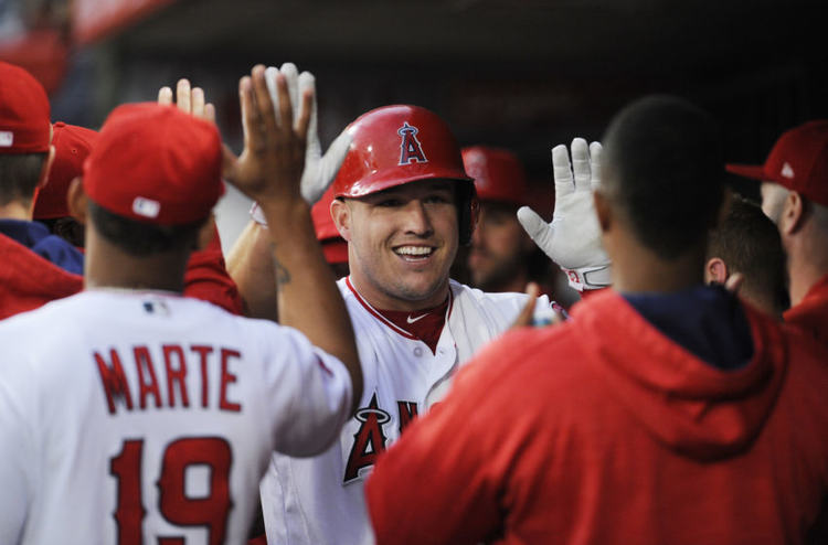 Los Angeles Angels players giving high fives