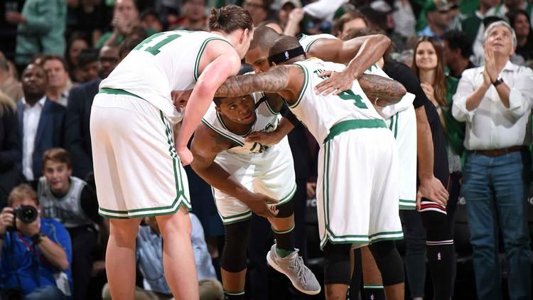 Boston Celtics players gathered around