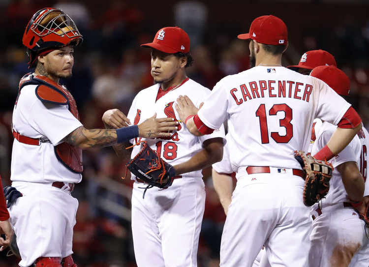 St. Louis Cardinals players gathered around