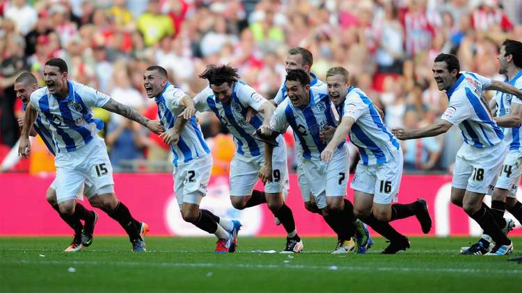 Huddersfield Town AFC players celebrating