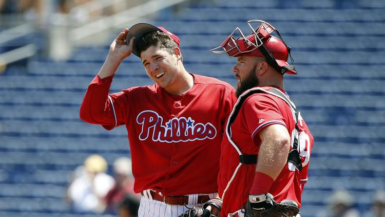 Phillies player Jerad Eickhoff talking to teammate