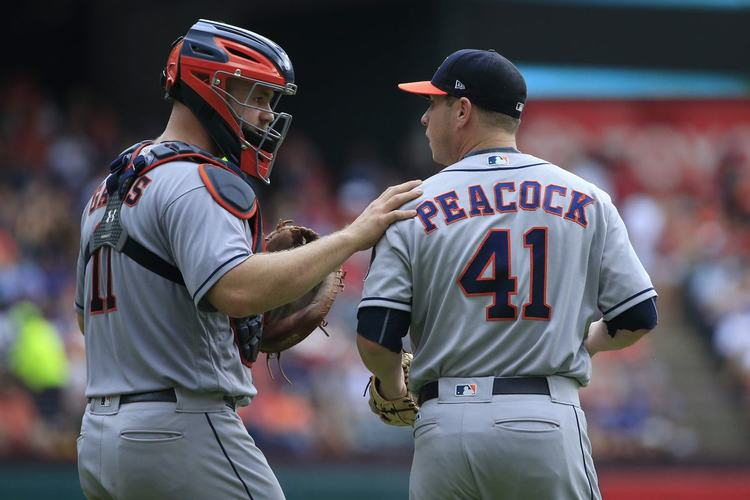 Astros pitcher Brad Peacock talking to teammate