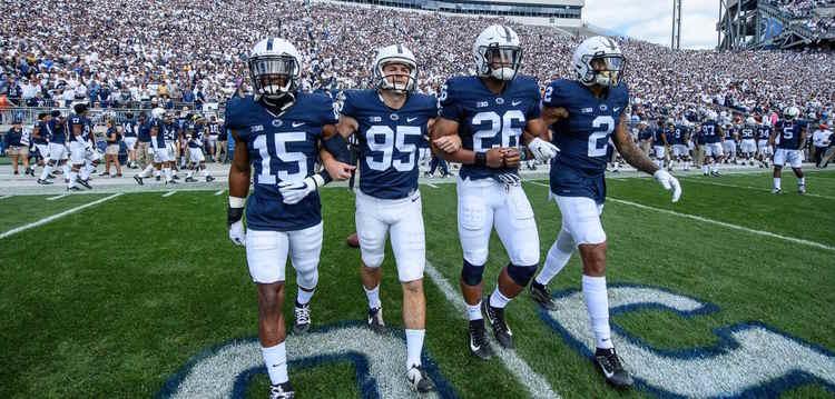 Georgia State players walking in field