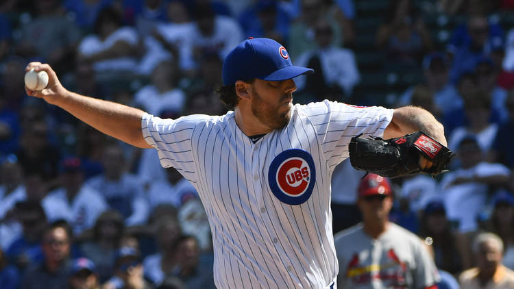 Cubs pitcher John Lackey in action