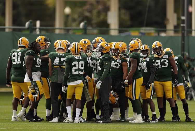 Green Bay Packers players gathered around