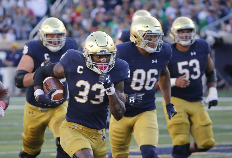 Notre Dame Fighting Irish players in action