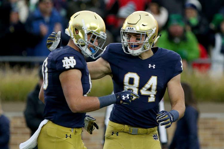 Notre Dame Fighting Irish players in field