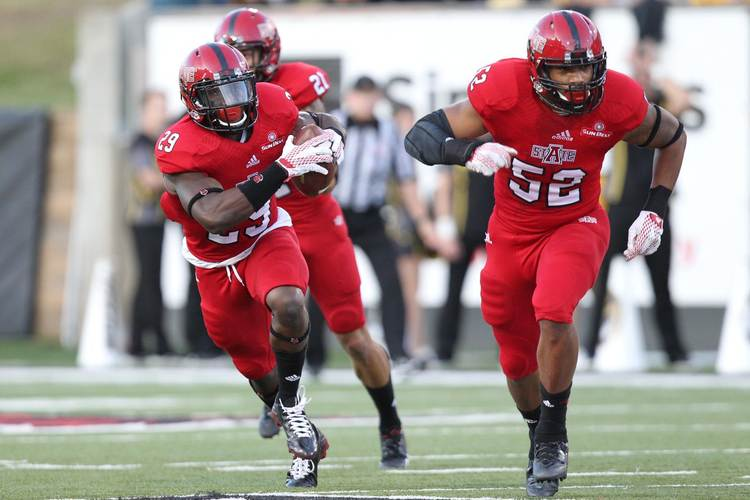Arkansas State Red Wolves players in action